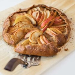 pie server pulling out a piece of apple galette