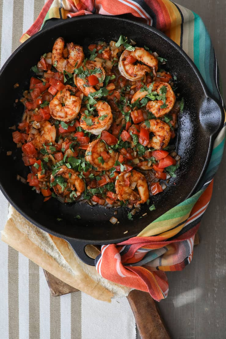 overhead shot of cooked mexican style shrimp camarones a la mexicana in skillet