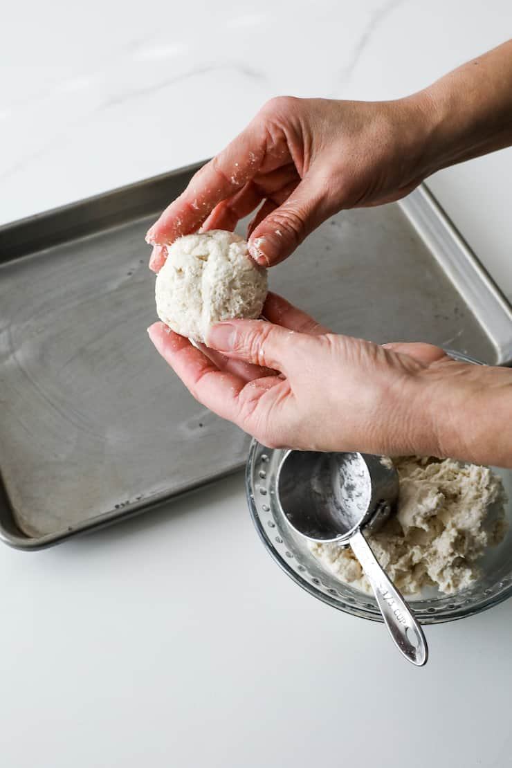 hands shaping biscuit dough