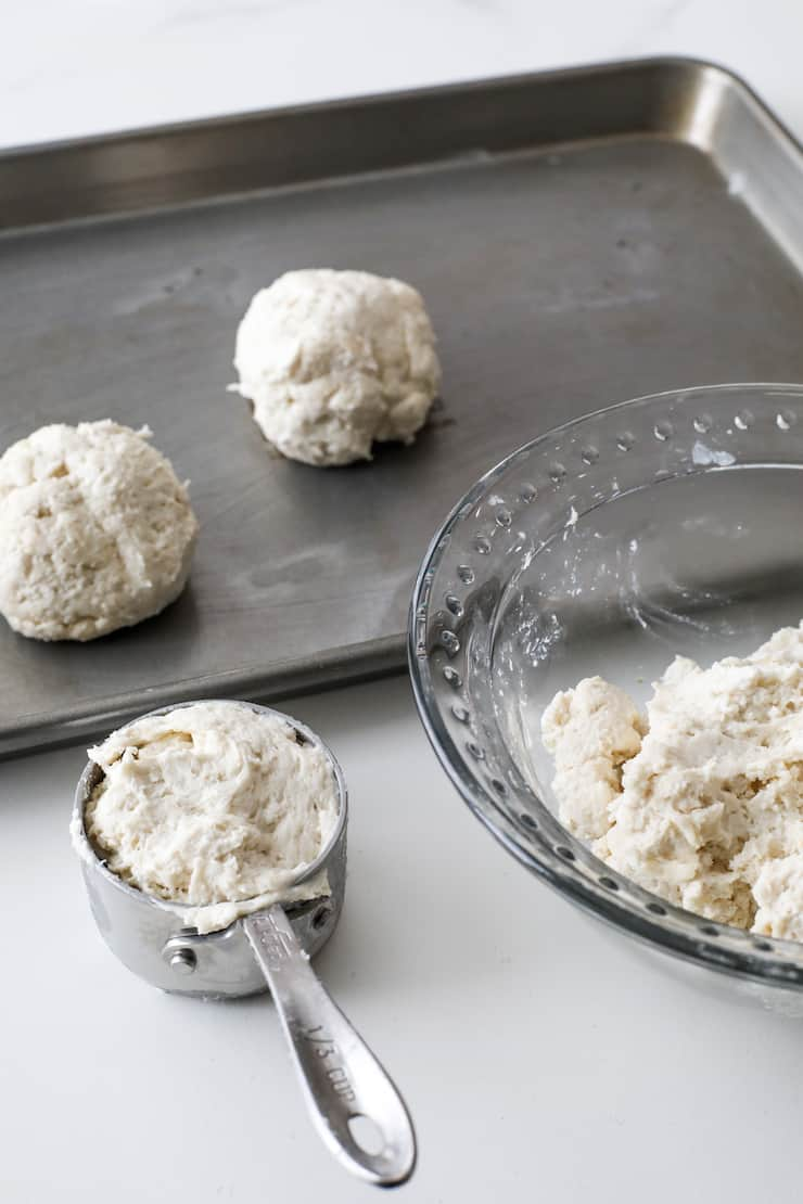 drop biscuit dough in a measuring cup to portion onto a sheet tray