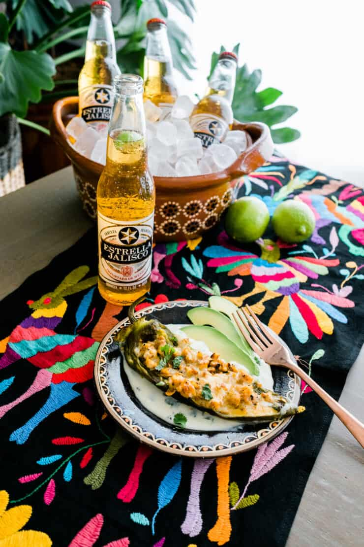 stuffed hatch Chile on an Otomi colorful runner and Mexican beer on the side