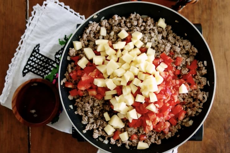 tomatoes and potatoes added to ground meat