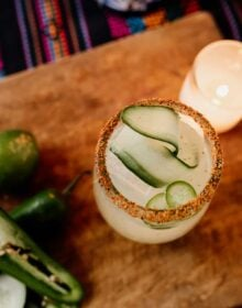 spicy cucumber margarita top down with a ribbon of cucumber