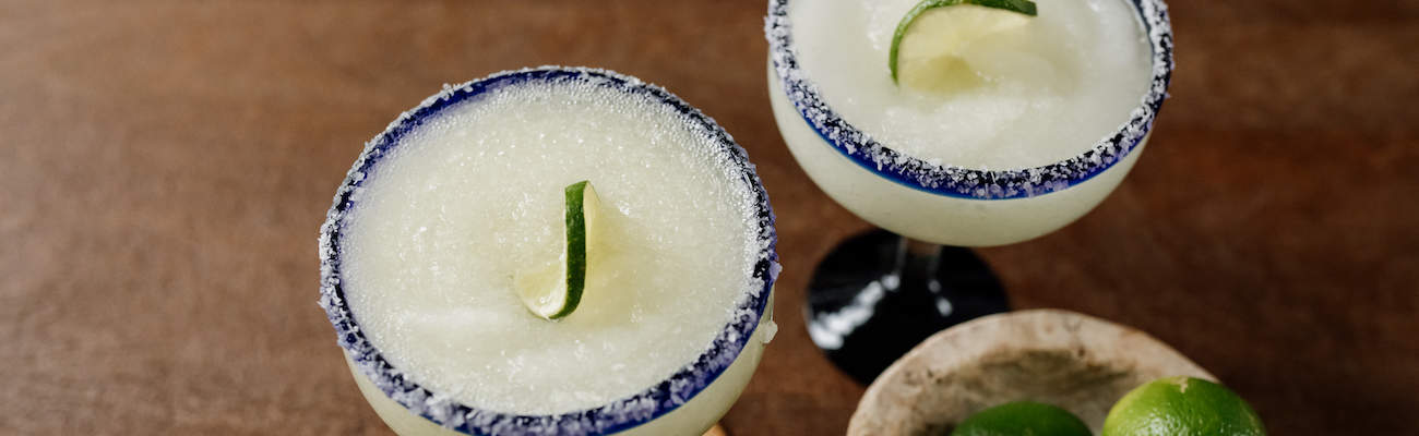 two frozen lime margarita cocktails