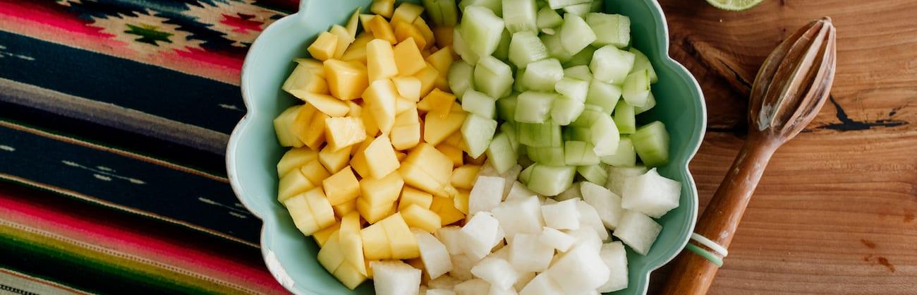 mango cucumber jicama cubes in a bowl
