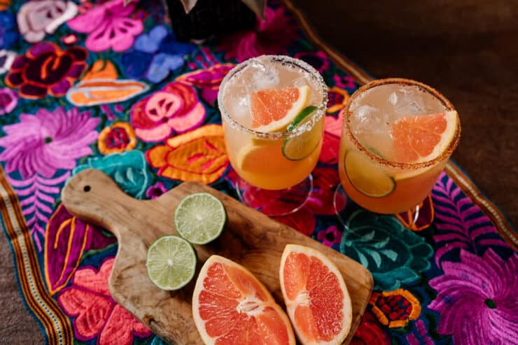 colorful Mexican runner with two Paloma cocktail glasses