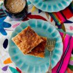 Sopapilla Cheesecake Bars on colorful linens