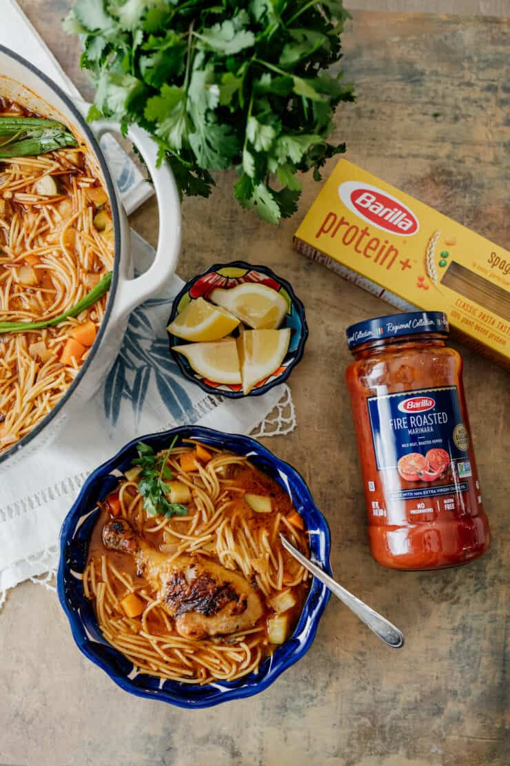 serving of fideos con pollo with barilla products on the side