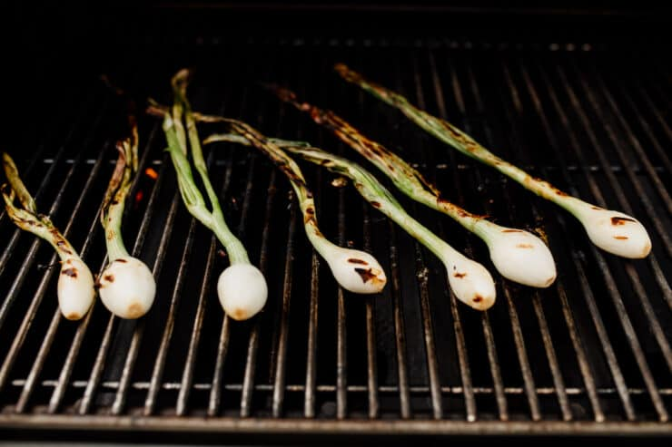 spring onions grilling directly on the grill grate