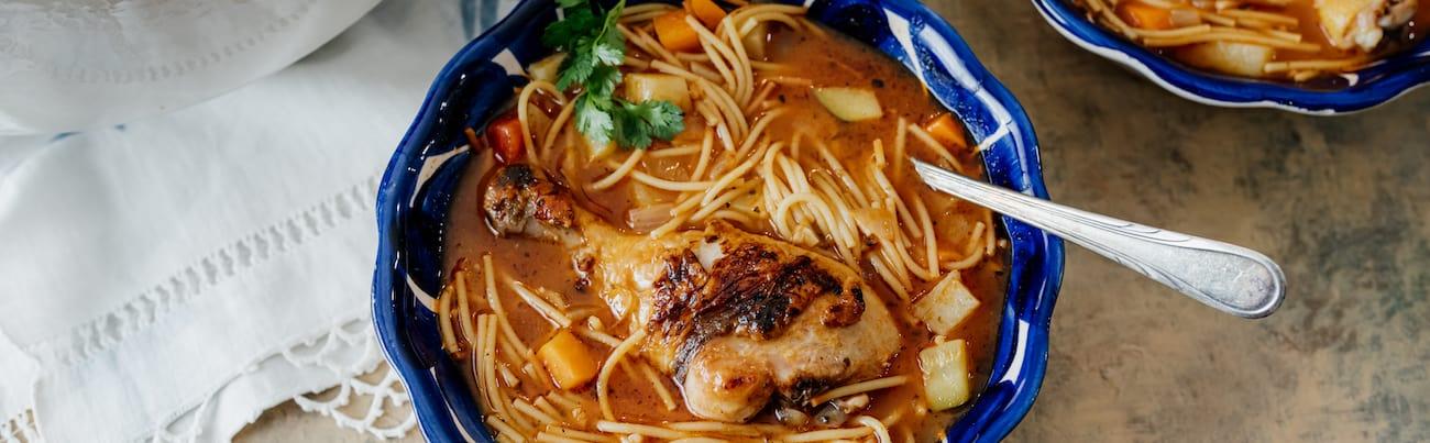 blue bowl full of sopa de fideos con pollo