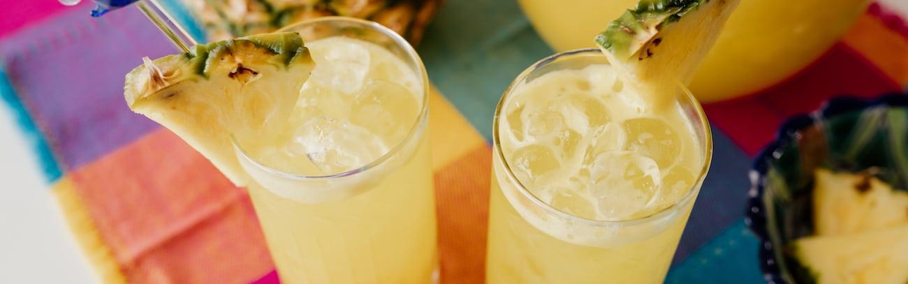 two glasses of pineapple agua fresca
