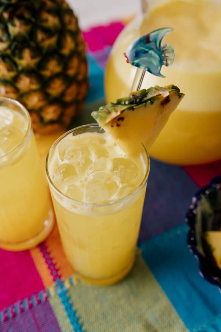 two collins glasses filled with agua de pina