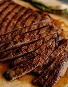 close up shot of sliced carne asada on a cutting board