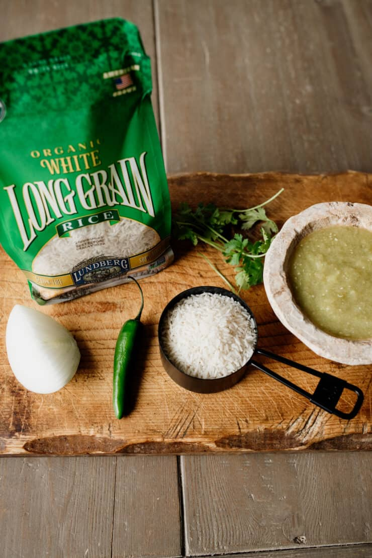 long grain rice package and in measuring cup with a side of salsa verde