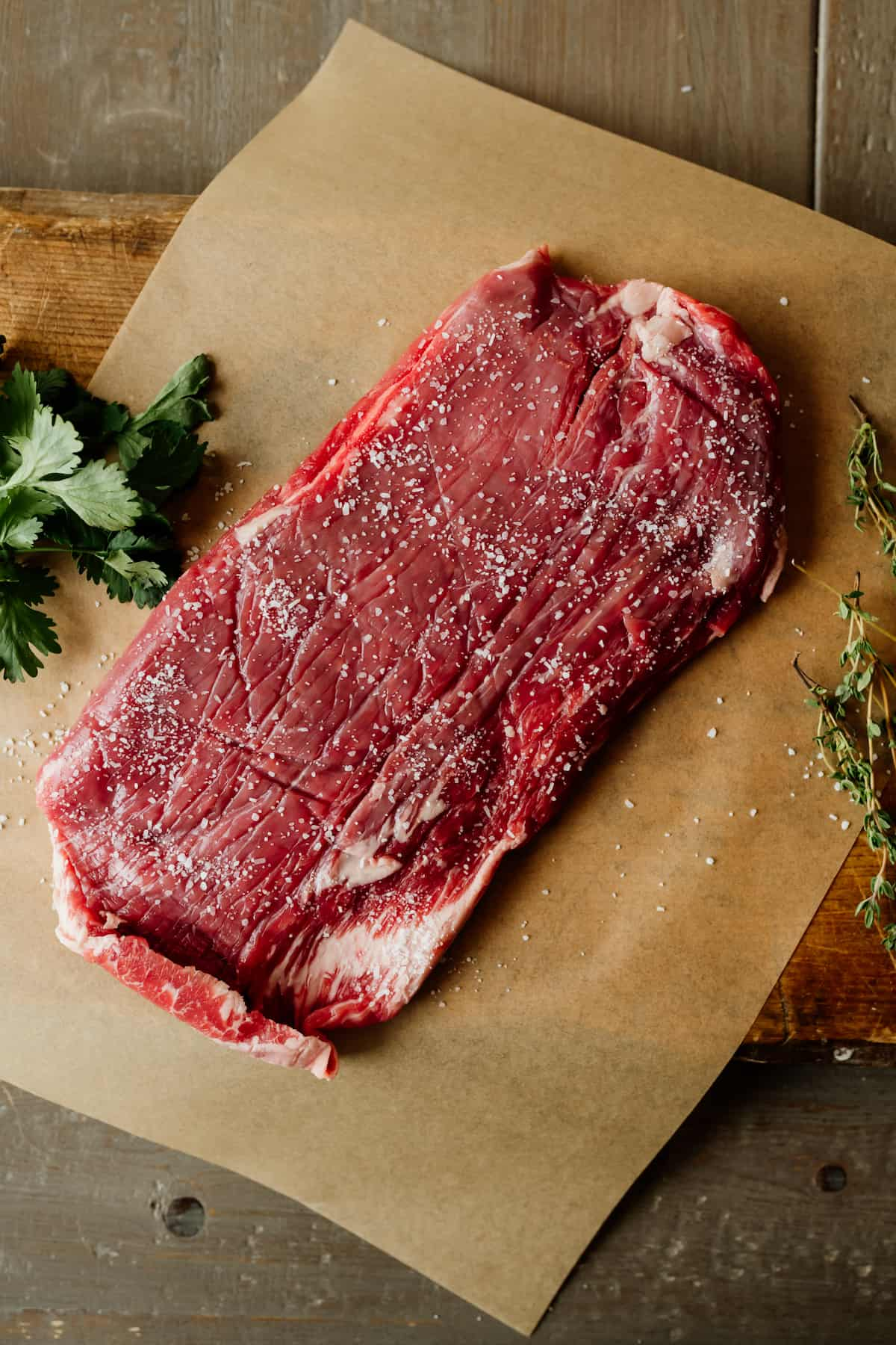 raw skirt steak on a piece of parchment and lightly sprinkled with salt