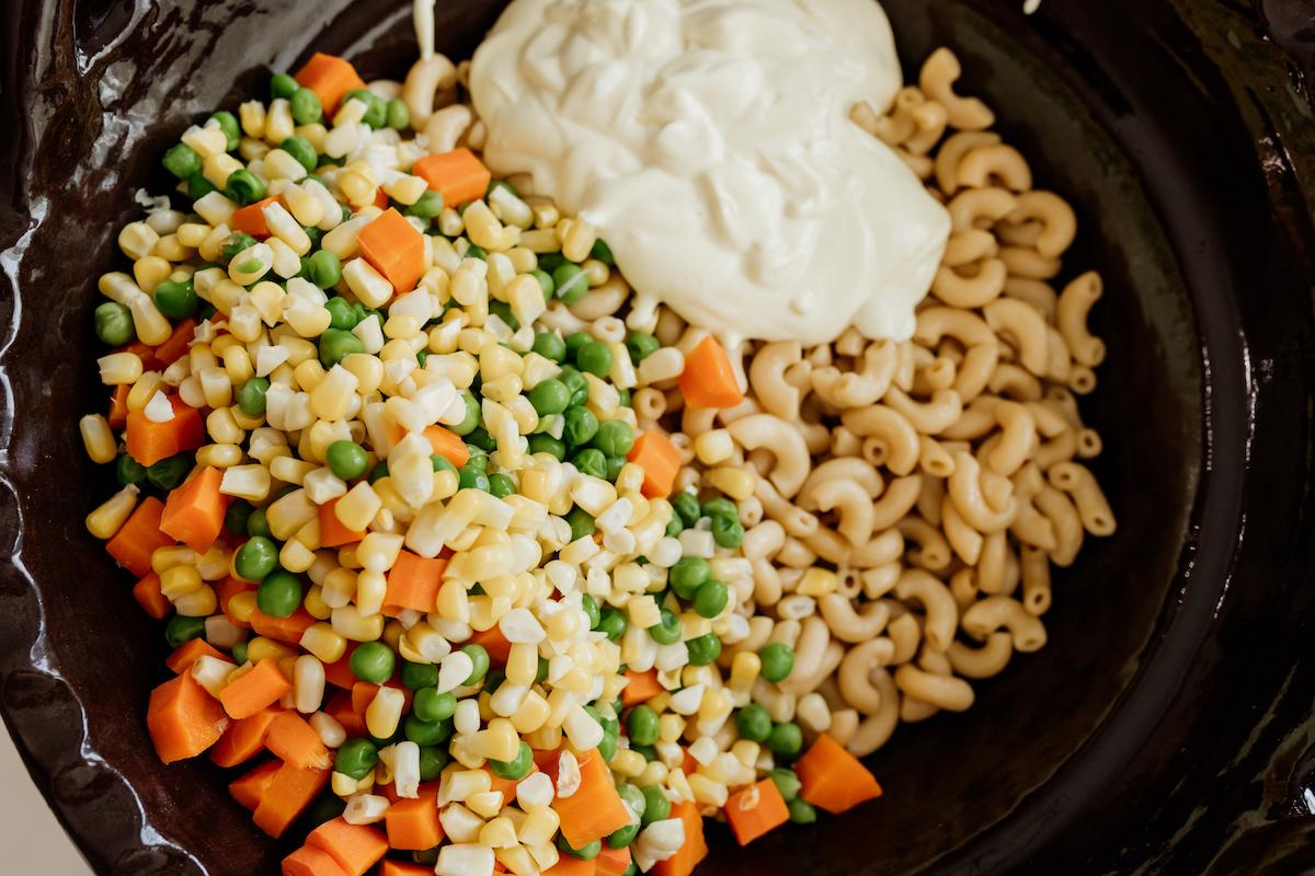 ingredients to make Ensalada de Coditos (Macaroni Salad) in a Mexican brown barro bowl
