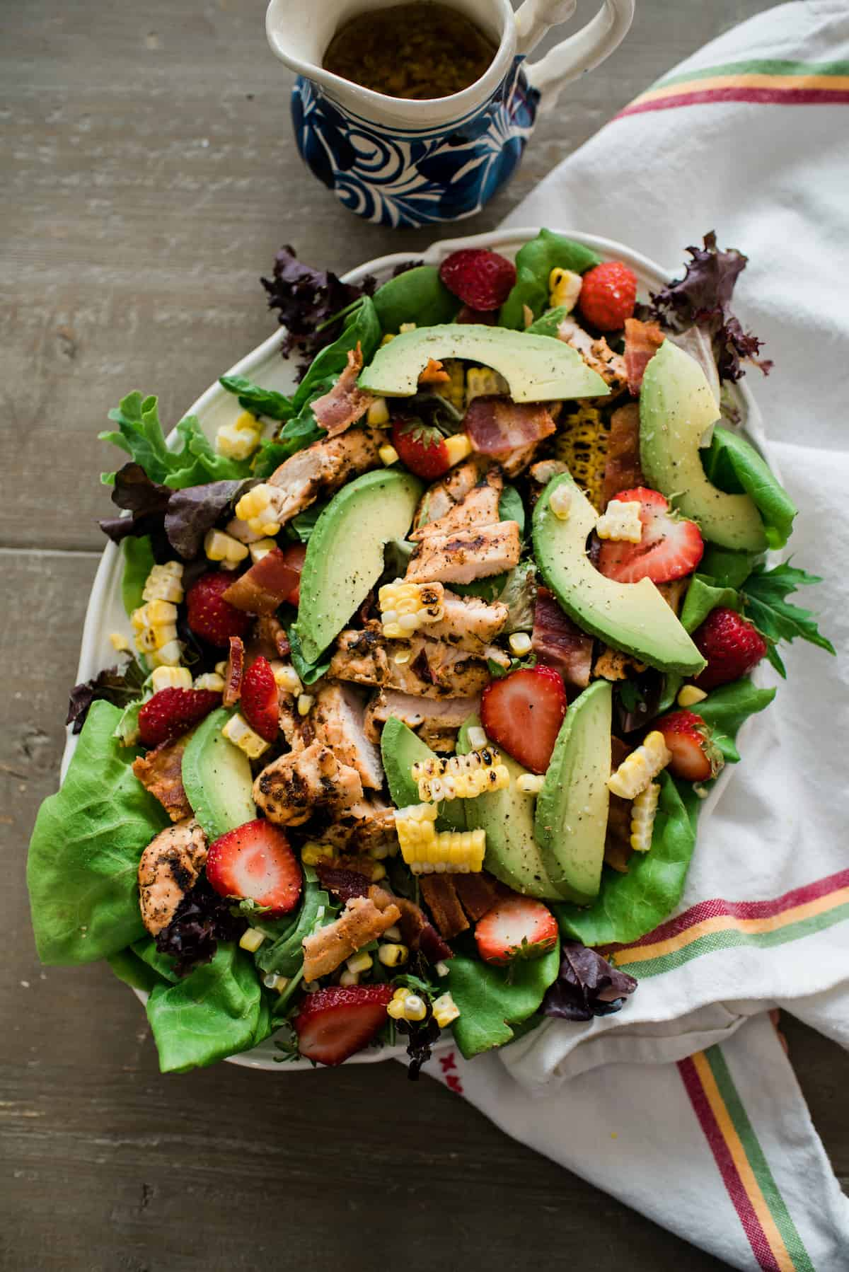 Mexican Cobb salad arranged on a large white serving platter