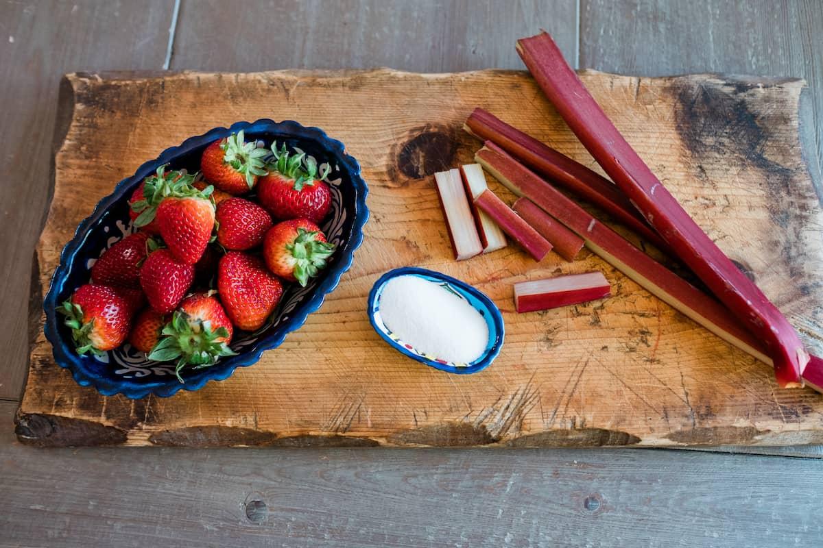 strawberries, rhubarb and sugar for making crostata filling