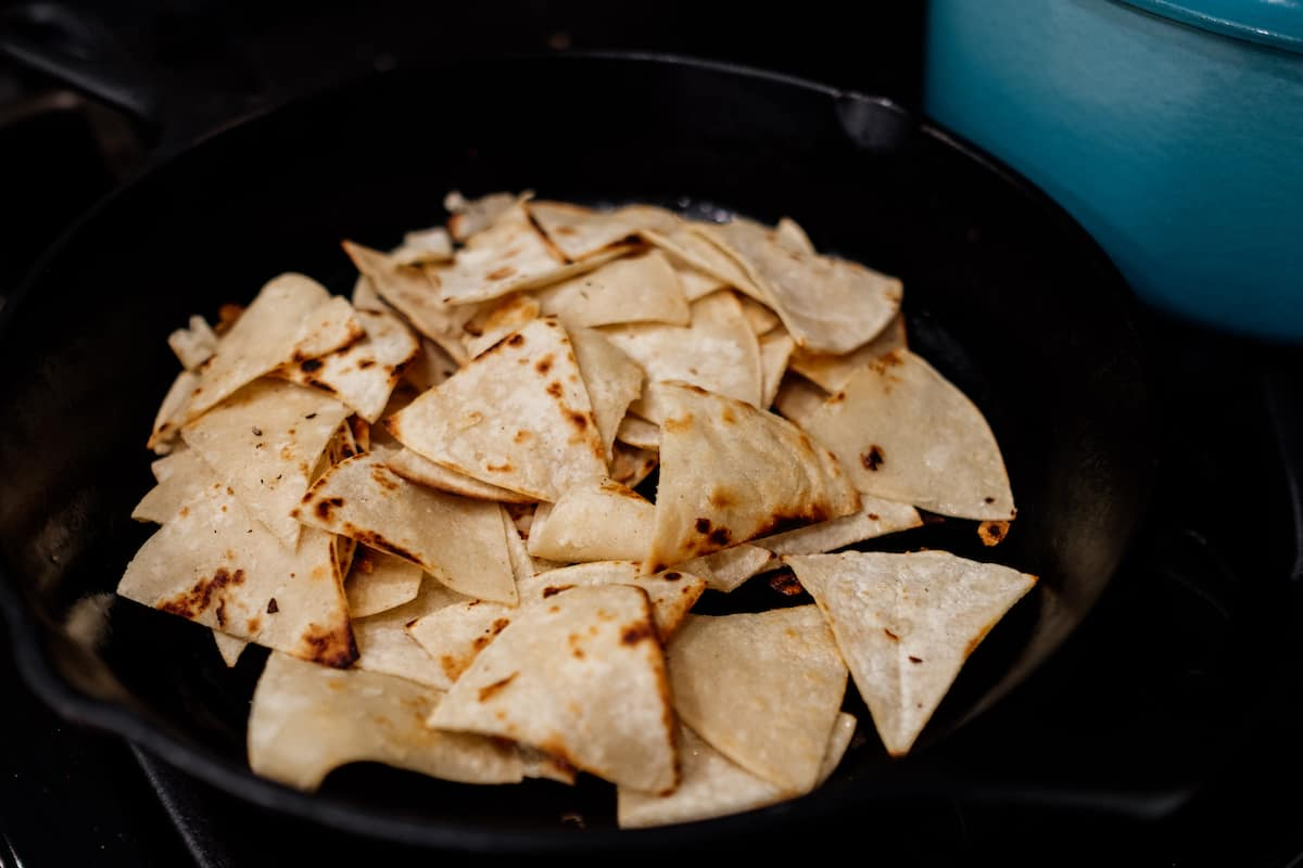 fried corn tortilla chips in a cast iron skillet