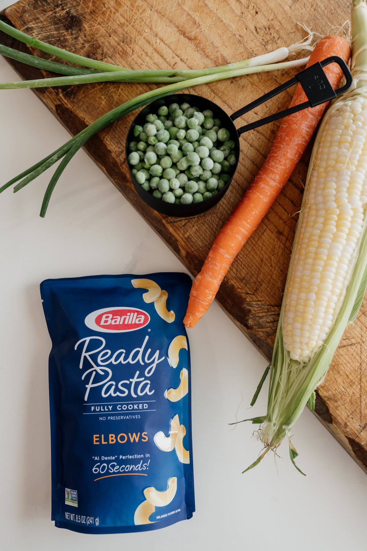 Barilla Ready Pasta pouch with fresh ingredients on a cutting board