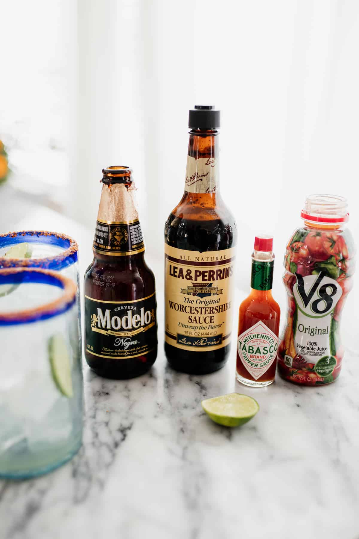 ingredients to make a spicy michelada: Mexican beer modelo, Worcestershire Sauce, Tabasco, V8 and lime