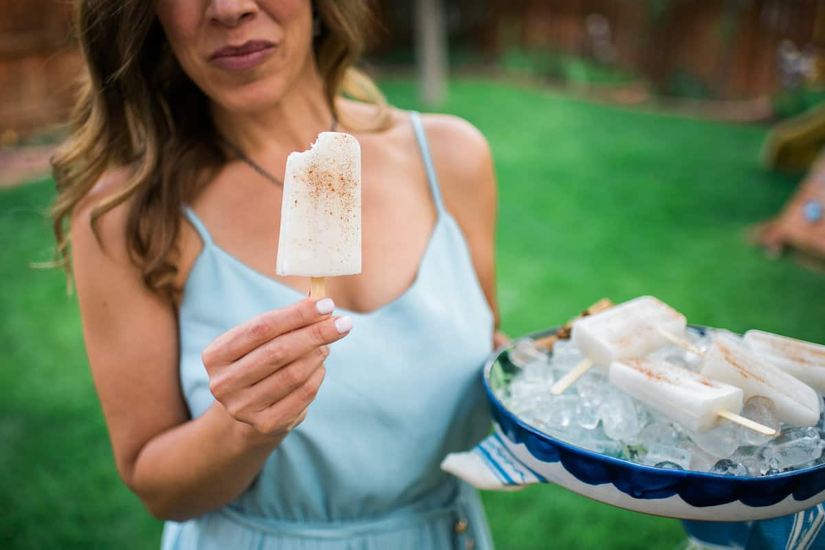 Yvette Marquez Latina food blogger holding an horchata Paletas popsicle