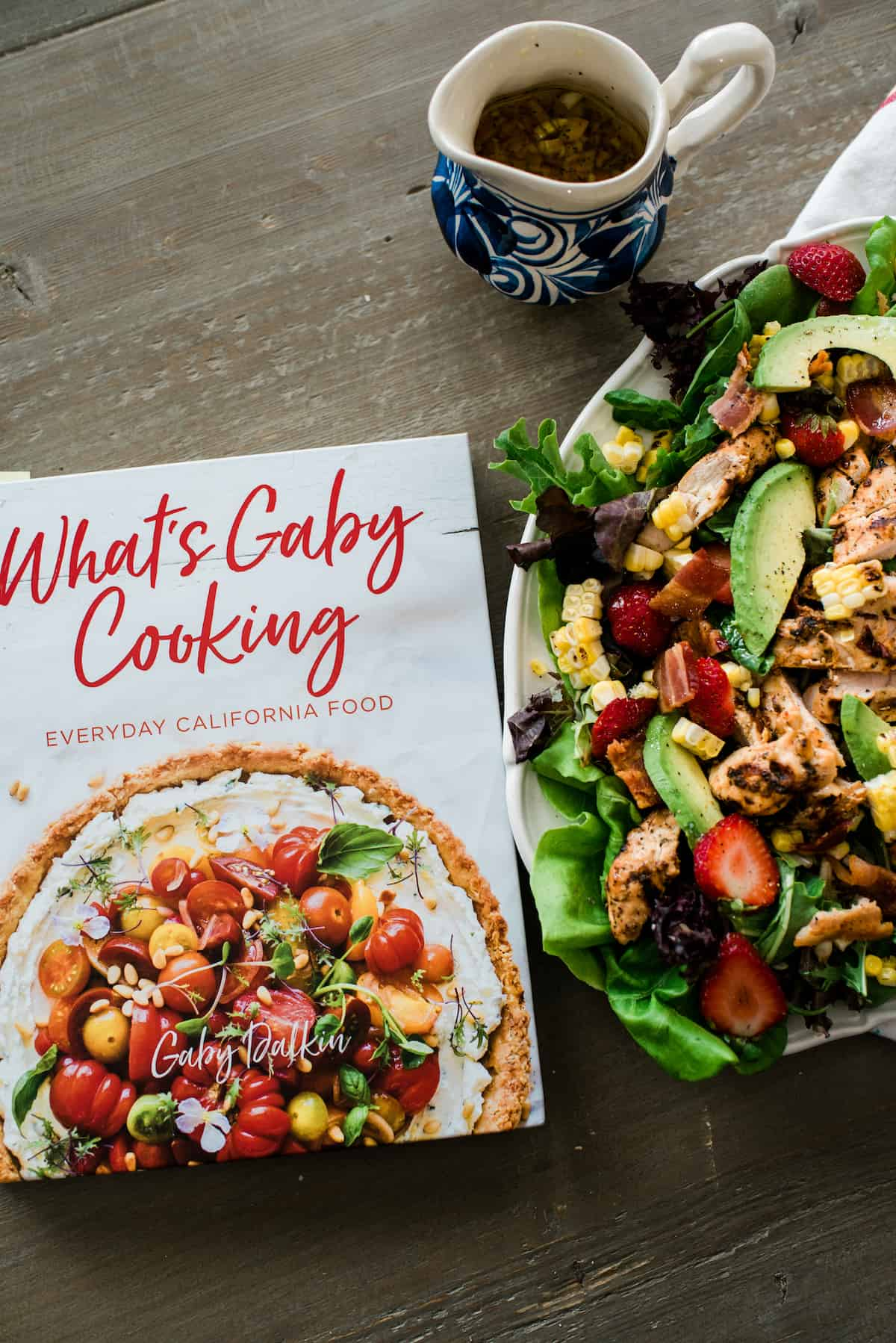 what's gaby cooking cookbook next to the plated summer chipotle chicken salad