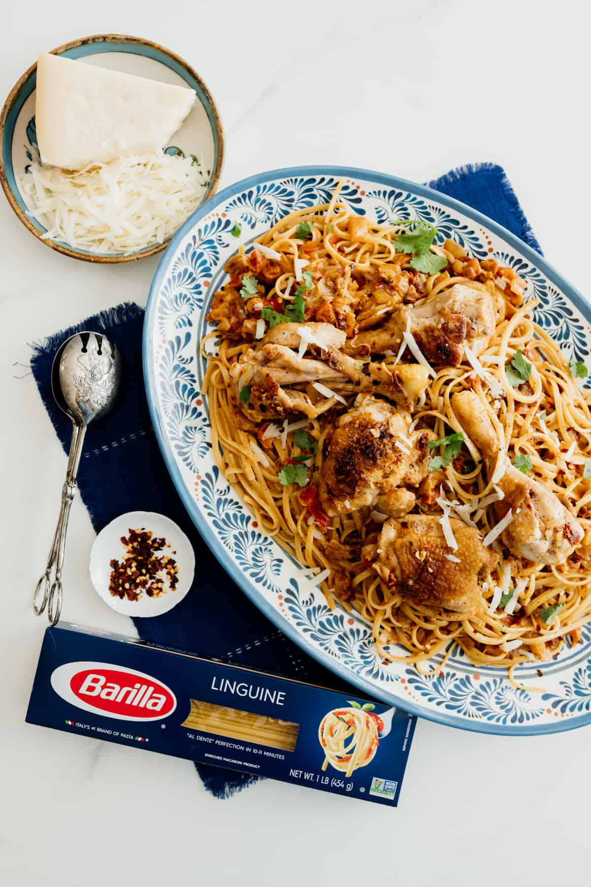 barilla linguine box on the side of a platter if chicken pasta