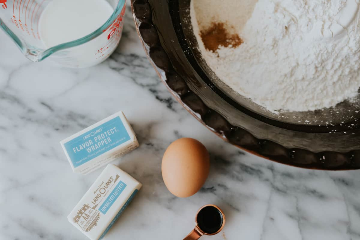 dry ingredients in a bowl and an egg, butter, and milk measured on the side