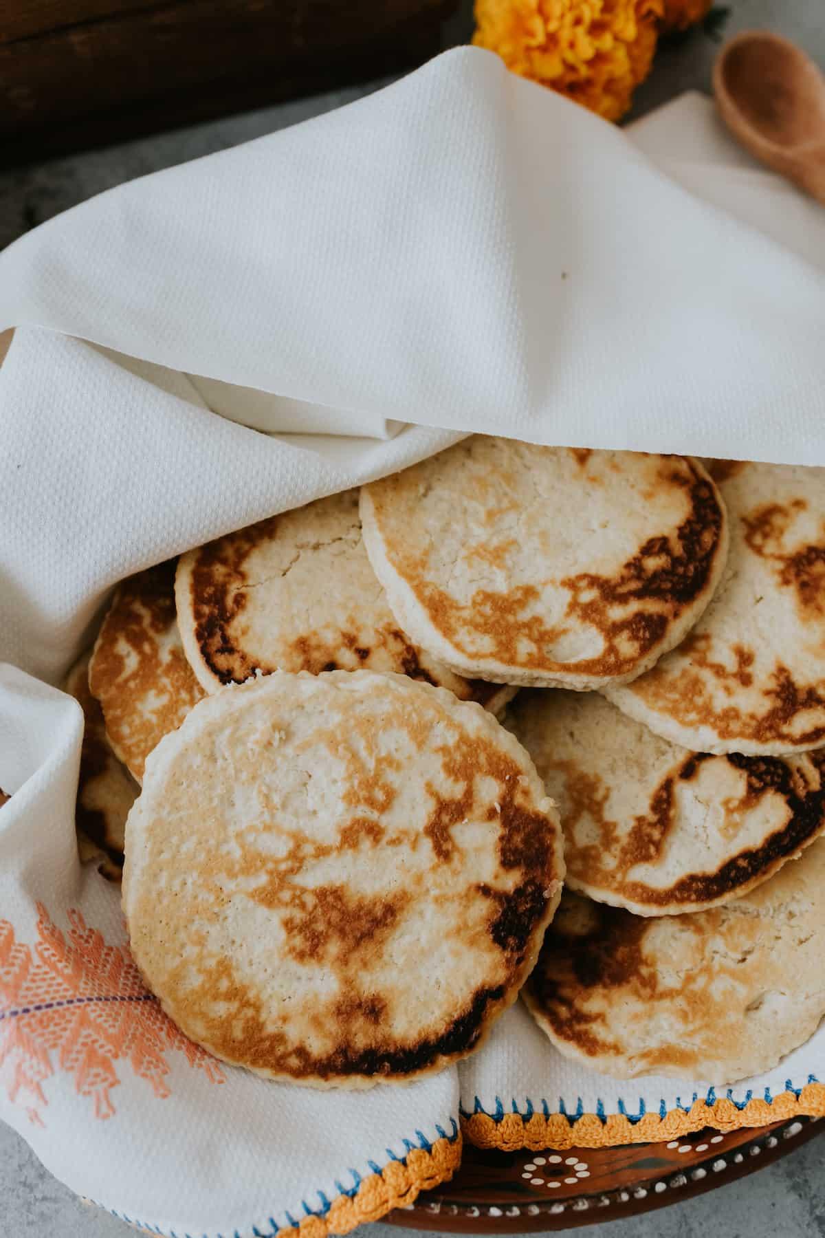 Gorditas de Azucar (Sweet Griddle Cakes) kept warm in a white Mexican linen