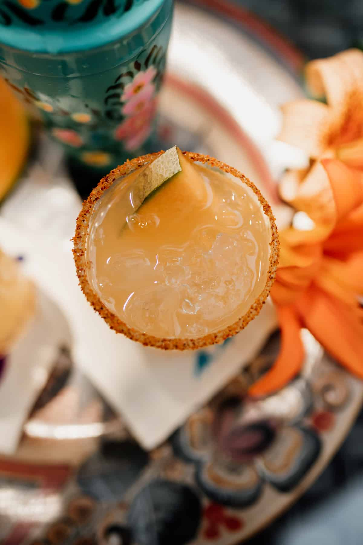 top down view of a Cantaloupe Melon Margarita rimmed with Tajin