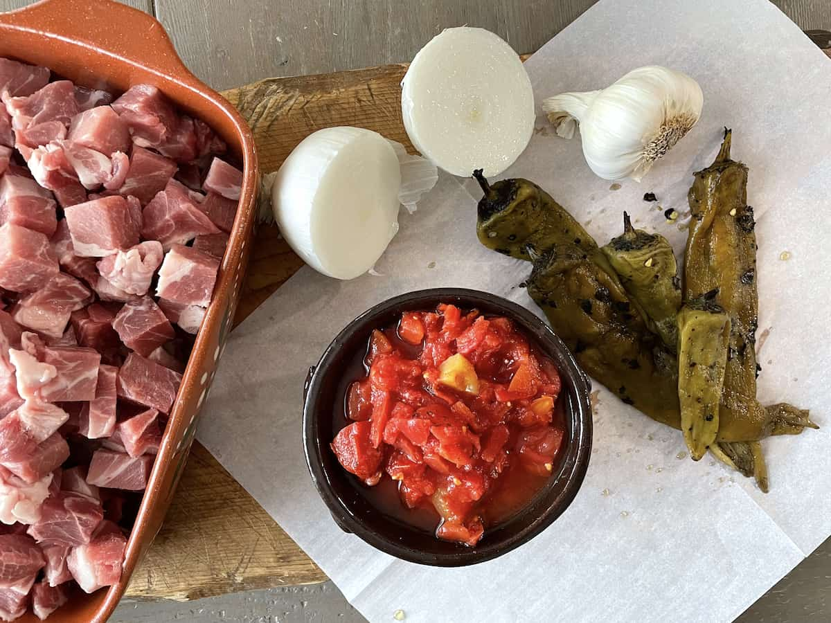 chopped raw pork, roasted canned tomatoes, roasted green chile, onion, garlic